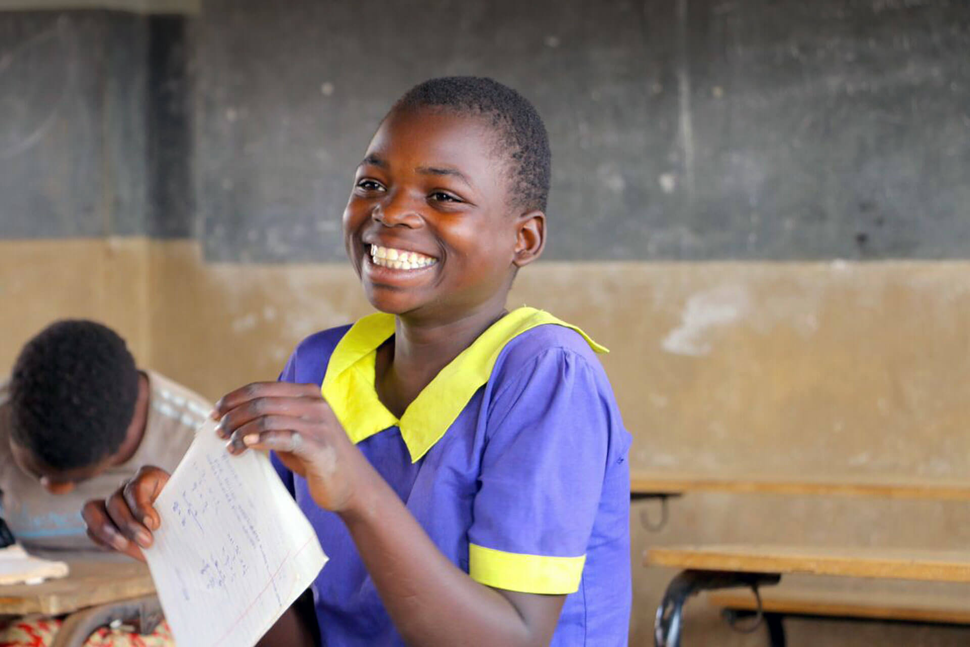 A confident Lucy Chalire smiles after she completes her end of year mathematics exam at Namera Primary school. Lucy is a fairly bright student as she usually finishes third in a class of 45. Despite these achievements, attending school has not always been easy for Lucy, mostly due to the lack of access to safe water in her area which greatly affected her learning. The situation is different now; a solar powered water pump was installed in an area encompassing Lucy's village and school, by UNICEF Malawi with funding from the European Union. The solar pump has transformed life in Lucy's community, and the number of children at Namera Primary School has increased from 300 to 449 as a direct result of the pump. The lack of access to adequate and clean water negatively impacts the health and education of children, especially girls. Absenteeism in school is common as many children become vulnerable to diseases such as diarrhoea. In homes, water supply impacts directly on the lives of women and girls since they are the ones who carry water, often at a long distance. In helping communities realise access to better and clean water supply, UNICEF has partnered with the European Union and the Ministry of Education Science and Technology and other partners to implement reticulated solar powered systems tapping ground water - serving schools, health centres, communities and other facilities.